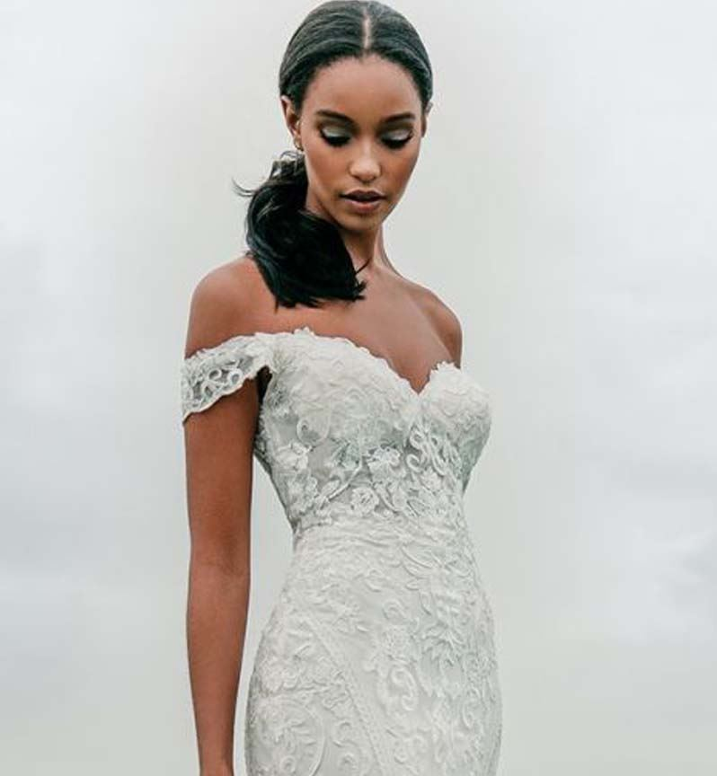 Model wearing a white Allure Bridals gown